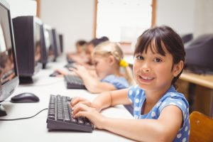 Cute pupils in computer class at the elementary school